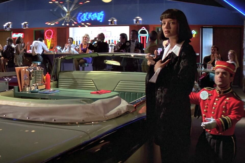 Quentin Tarantino's Pulp Fiction (1994) sets the stage for a dining booth fashioned out of a convertible 50's car