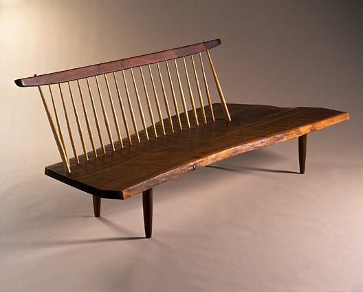 Conoid bench in Walnut and hickory