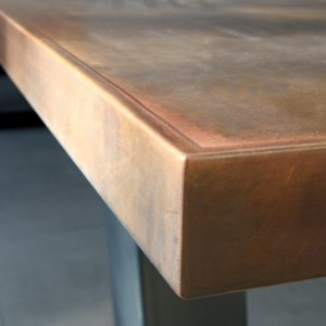 Aged copper table with edge finish